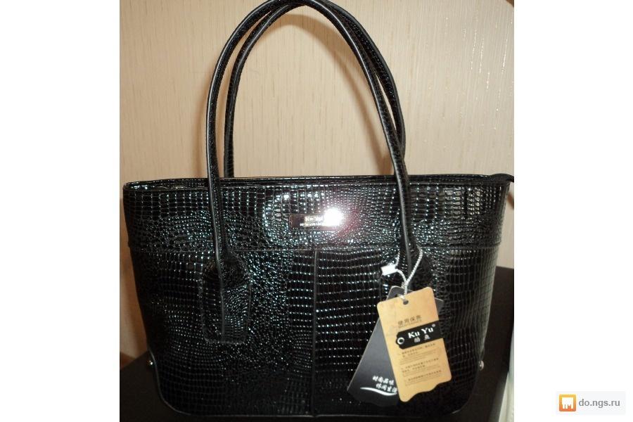 Лаковая черная сумка из кожи